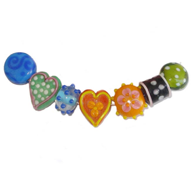 Lampwork fancy glass beads 7 pieces strung in a thread,