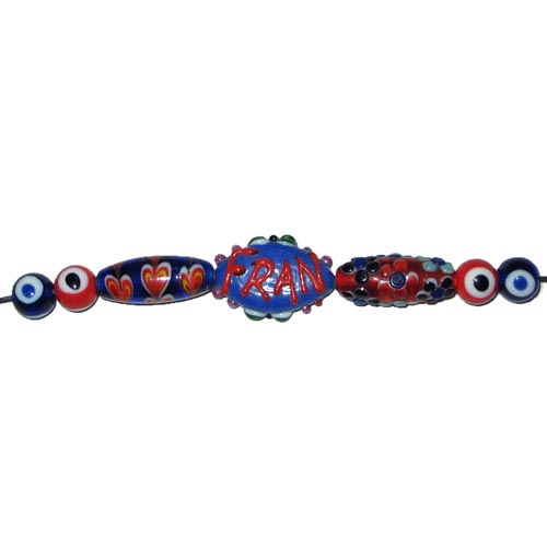 Lampwork fancy glass beads 10 pieces strung in a thread,