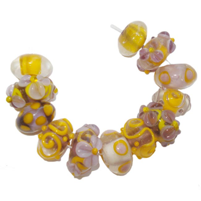 Lampwork fancy glass beads 12 pieces strung in a thread,