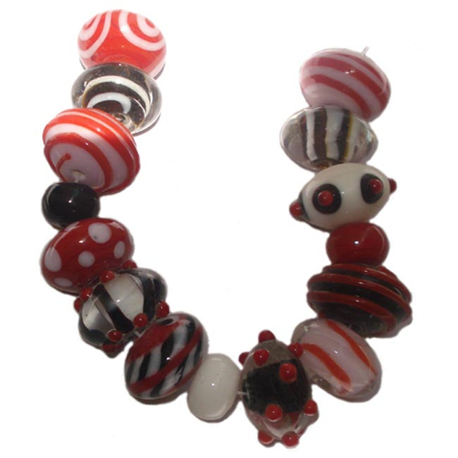 Lampwork fancy glass beads 15 pieces strung in a thread,