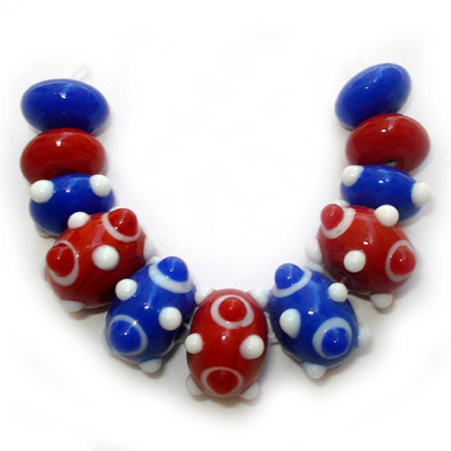 Lampwork fancy glass beads 11 pieces strung in a thread,