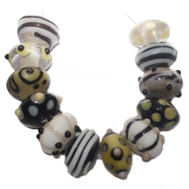 Lampwork fancy glass beads 23 pieces strung in a thread,
