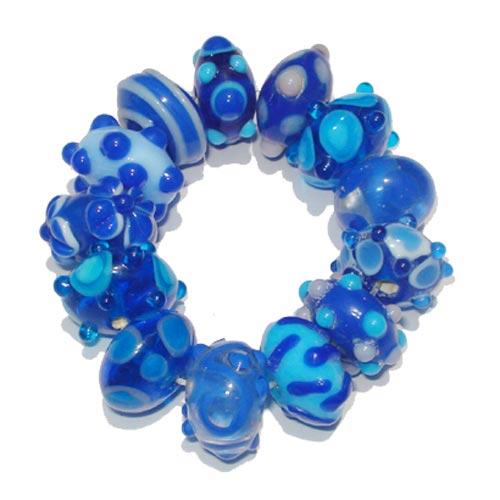 Lampwork fancy glass beads 13 pieces strung in a thread,