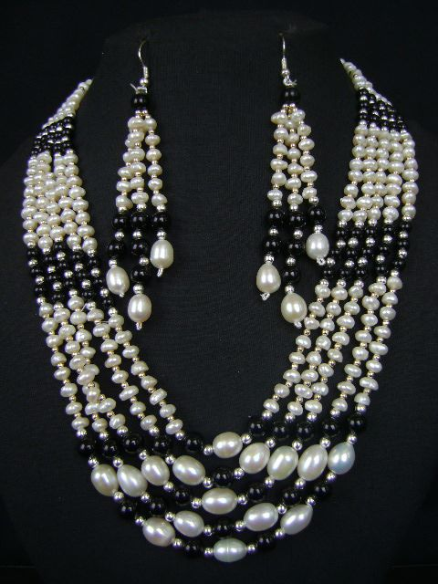 Carved Elegantly With Exquisite Workmanship Pearl Necklace Set at very affordable price